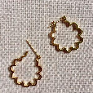 Small gold hoop earrings.